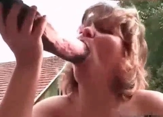 Busty female is jerking a huge stallion dick